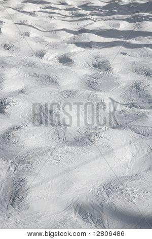 Mogul snow ski trail.