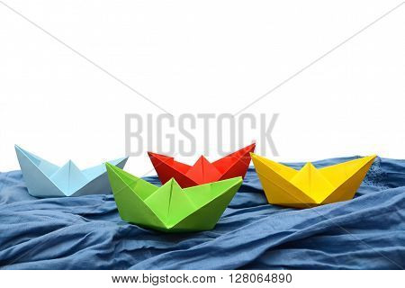 Colored paper boats, origami. Color origami. Paper.
