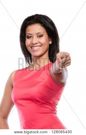 Stunning mixed race african american woman in red dress pointing at you. Gorgeous young girl isolated on white. Fashion.