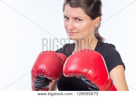 Portrait of a scared boxer woman with red gloves - isolated on white