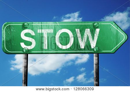 stow road sign , worn and damaged look