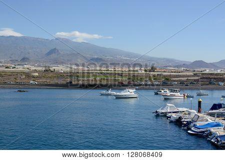 LAS GALLETAS, TENERIFE - APRIL 21, 2016: The small fishing town and port of Las Galletas, Tenerife