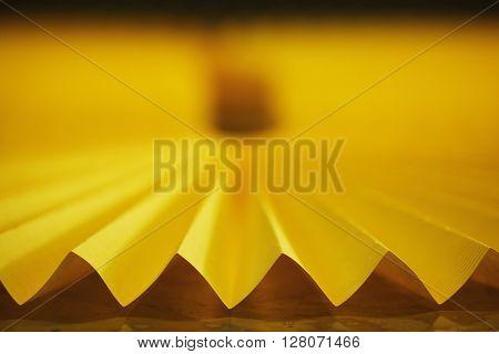 photo of yellow car filter close up