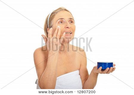 Older Woman Apply Skin Care Cream