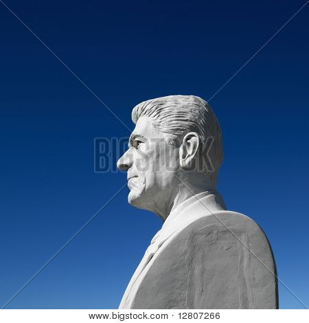 Bust of Ronald Reagan sculpture against blue sky in President's Park, Black Hills, South Dakota.