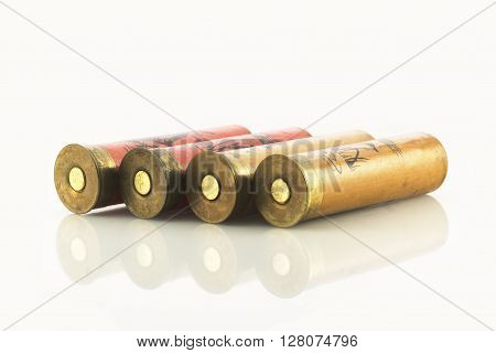 Hunting shotgun shells on white with reflections
