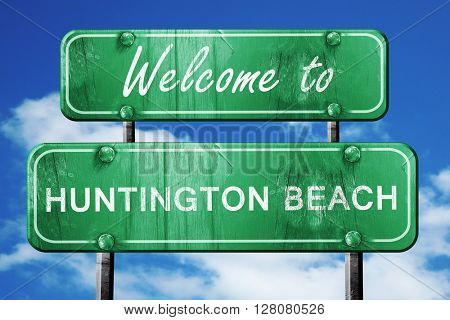huntington beach vintage green road sign with blue sky backgroun