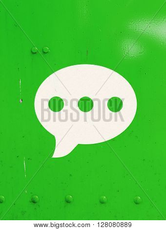 chat bubble icon in green color metal