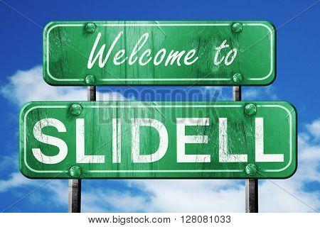 slidell vintage green road sign with blue sky background