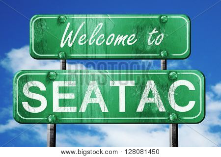 seatac vintage green road sign with blue sky background