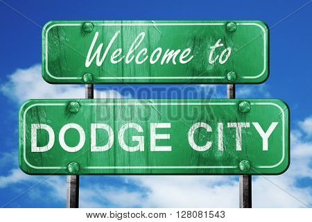 dodge city vintage green road sign with blue sky background
