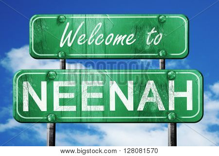 neenah vintage green road sign with blue sky background