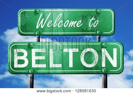 belton vintage green road sign with blue sky background