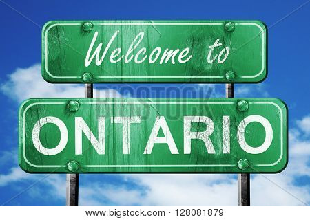 ontario vintage green road sign with blue sky background