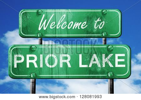 prior lake vintage green road sign with blue sky background