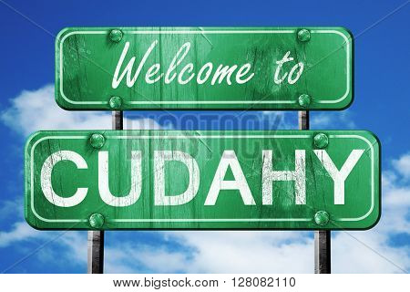 cudahy vintage green road sign with blue sky background