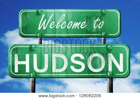 hudson vintage green road sign with blue sky background