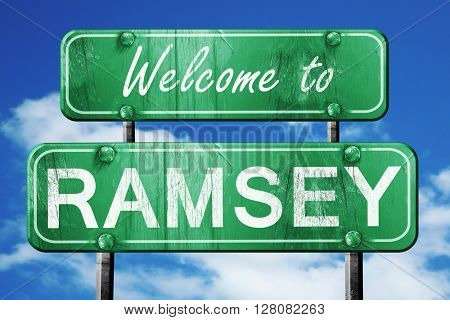 ramsey vintage green road sign with blue sky background