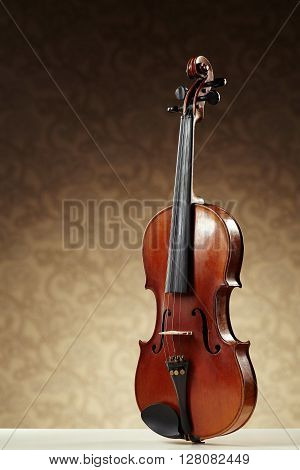 photo of aged handmade violin on brown