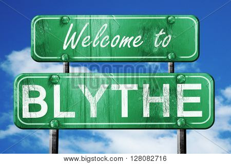 blythe vintage green road sign with blue sky background
