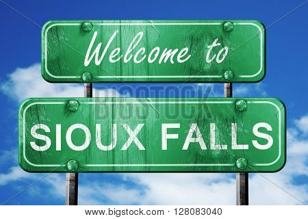 sioux falls vintage green road sign with blue sky background