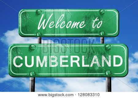 cumberland vintage green road sign with blue sky background