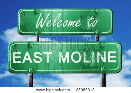 east moline vintage green road sign with blue sky background