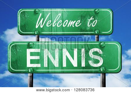 ennis vintage green road sign with blue sky background