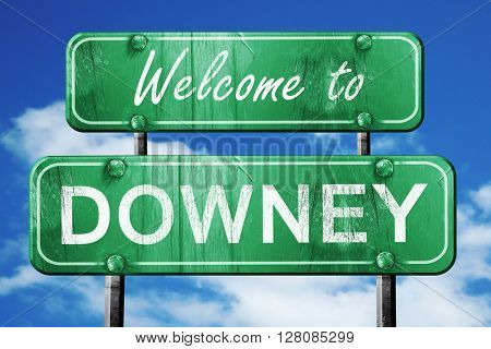 downey vintage green road sign with blue sky background