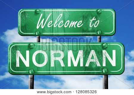 norman vintage green road sign with blue sky background