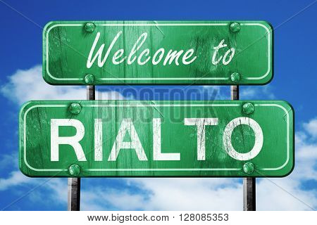 rialto vintage green road sign with blue sky background