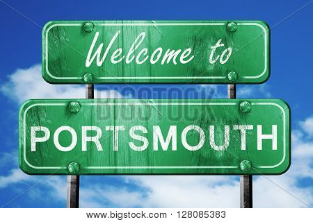 portsmouth vintage green road sign with blue sky background