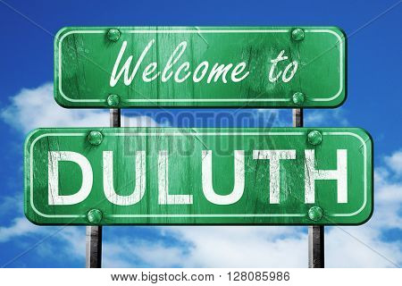 duluth vintage green road sign with blue sky background