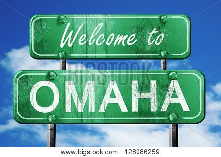 omaha vintage green road sign with blue sky background