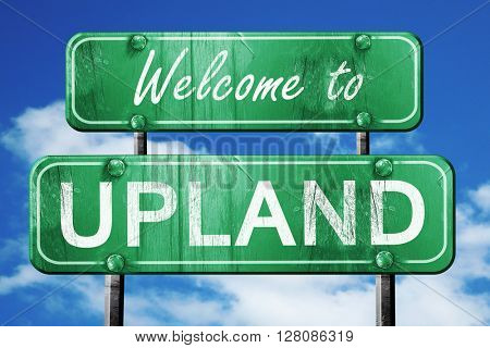 upland vintage green road sign with blue sky background