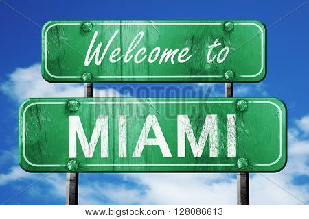 miami vintage green road sign with blue sky background