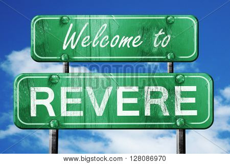 revere vintage green road sign with blue sky background