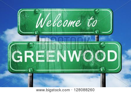 greenwood vintage green road sign with blue sky background