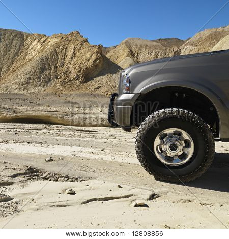 Four wheel drive truck in desert landscape in Death Valley National Park.