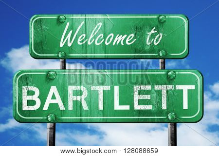 bartlett vintage green road sign with blue sky background