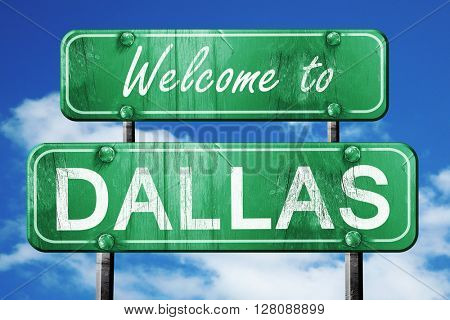 dallas vintage green road sign with blue sky background
