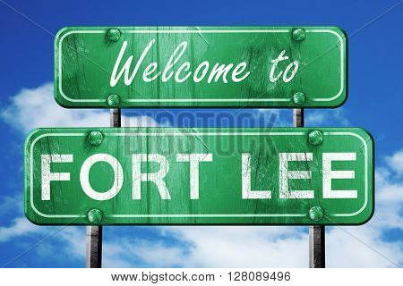 fort lee vintage green road sign with blue sky background