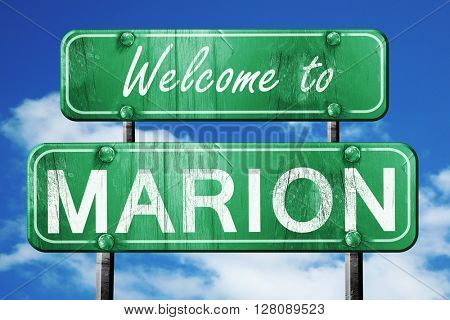 marion vintage green road sign with blue sky background