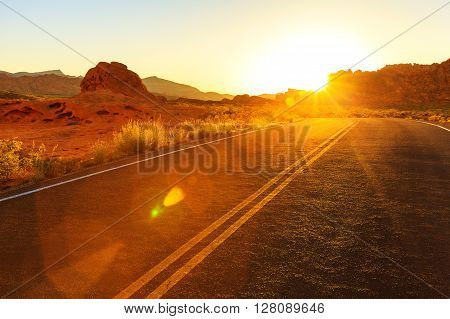 Red sunset over road in Southern Nevada Valley of Fire State Park USA