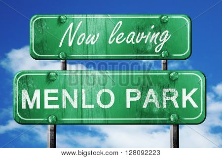 Leaving menlo park, green vintage road sign with rough lettering
