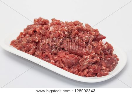 Stuffed meatloaf preparation : Ground beef on white background