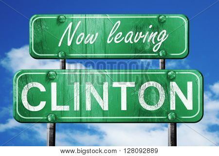 Leaving clinton, green vintage road sign with rough lettering