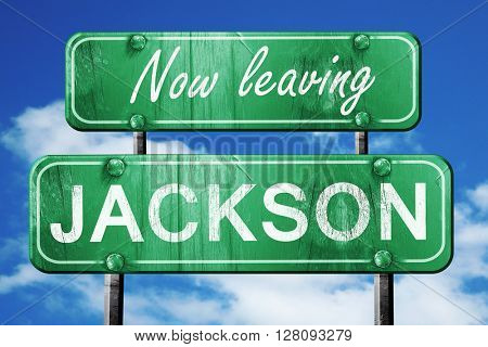 Leaving jackson, green vintage road sign with rough lettering
