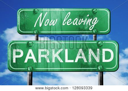 Leaving parkland, green vintage road sign with rough lettering