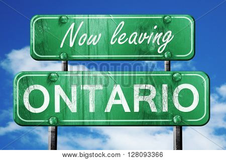 Leaving ontario, green vintage road sign with rough lettering